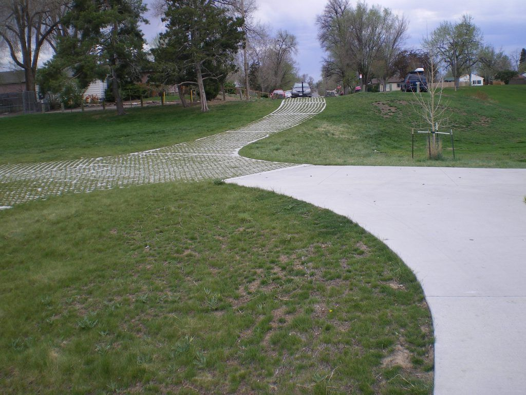 The Bomanite Grasscrete shown here is the green alternative to typical concrete surfaces, providing a variety of landscape solutions, and alleviating drainage issues while maintaining strong structural integrity.
