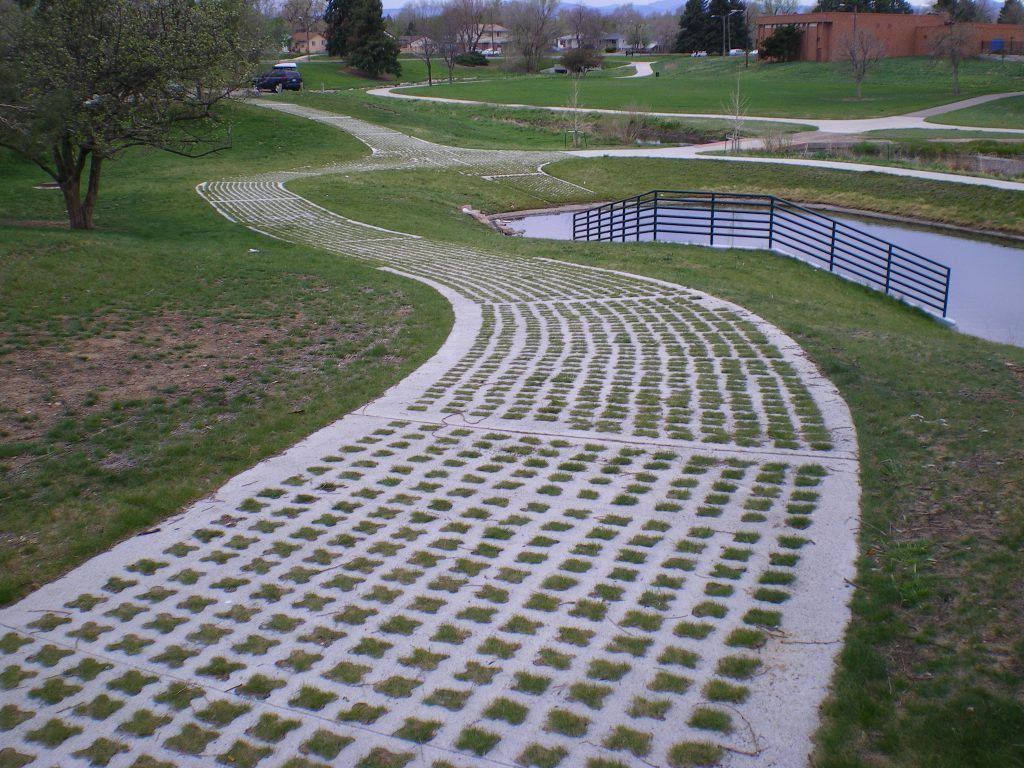Grasscrete by Bomanite was chosen here to provide a pervious concrete system that will allow water to pass freely through while maintaining a structural integrity that is suitable to support the weight of the required maintenance vehicles.