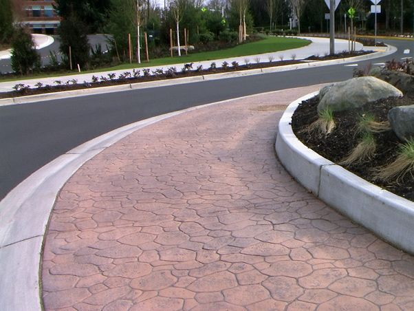 The Bomacron Creek Stone pattern by Bomanite was a great choice to pair with the beautifully chosen landscape and creates a feel of nature in the midst of busy city traffic.