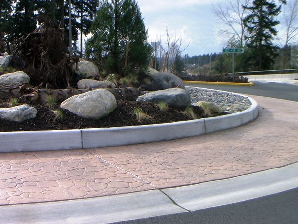 Bomanite stamped concrete was installed here to create a functional hardscape roundabout and add an element of artistic design that complements the surrounding landscape.