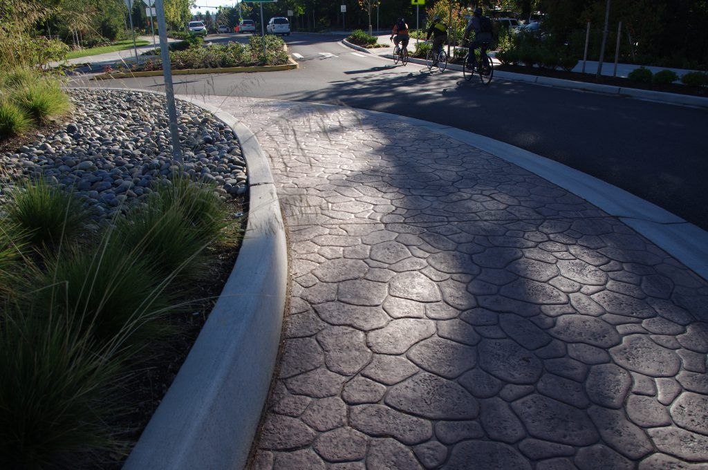 While entering and exiting the NE 36th Street Bridge, drivers navigate around this decorative roundabout, that showcases beautiful custom-colored Bomanite Bomacron stamped concrete.