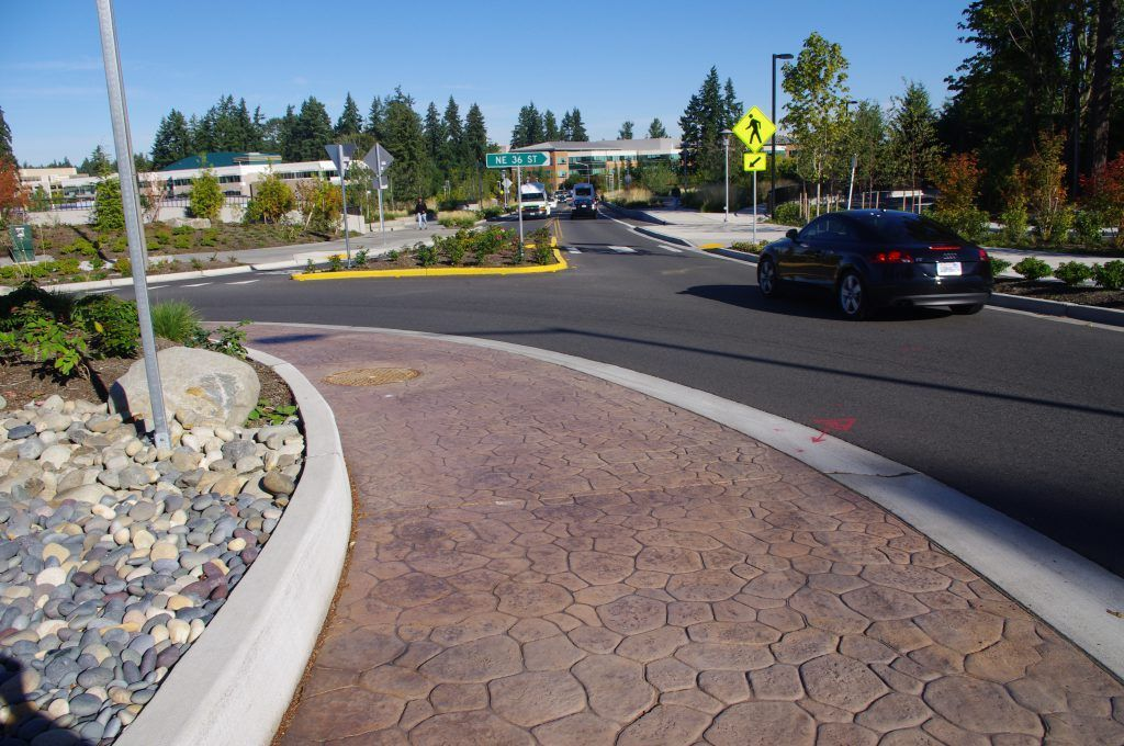 The 36th Street Bridge roundabout pictured here in Redmond, Washington incorporates Bomanite stamped and sealed concrete to compliment the surrounding landscape.
