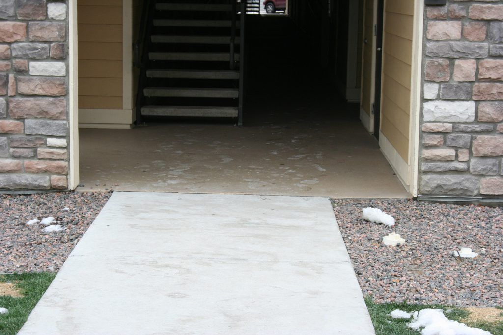 The building entryways at this apartment complex feature Bomanite Broadcast Aggregate concrete, chosen because it provides highly durability, low maintenance, and an easy to clean surface.