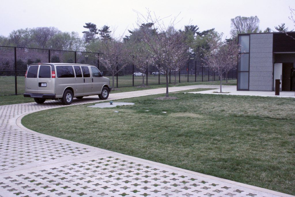Approximately 2,000 square feet of Grasscrete by Bomanite was installed here in a Buff Integral color with the voids being planted with grass, adding a beautiful natural element that ties into the surrounding landscape design.