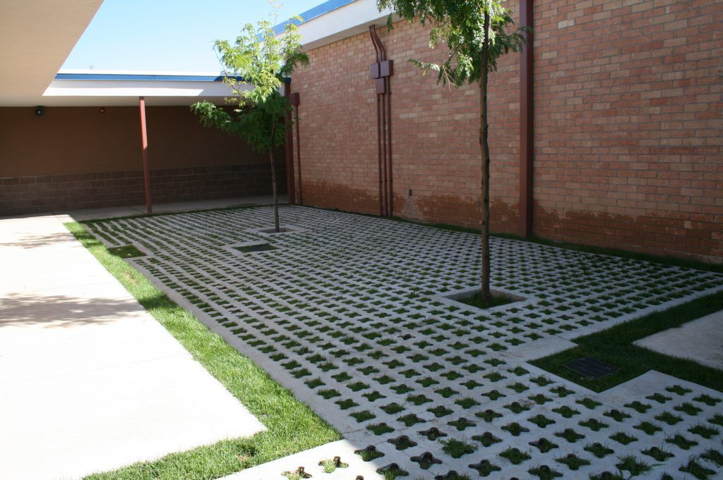 """Bomanite Grasscrete was installed here as a sustainable and """"Green"""" landscape solution that would allow for foot traffic across the courtyard without destroying the planted grass as well as provide proper drainage for the area."""