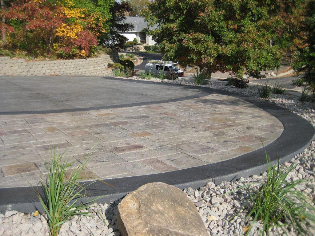 A perfect interplay of color and texture were adding to this driveway landing with the use of Bomanite Bomacron patterns and Bomanite Integral colored concrete.