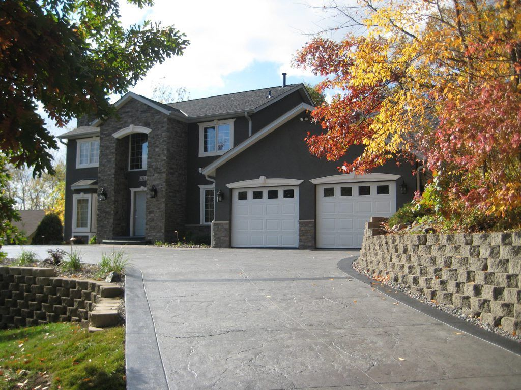 Bomanite Imprinted concrete was used here to create a durable and decorative concrete driveway that blends flawlessly with the architecture of the home.