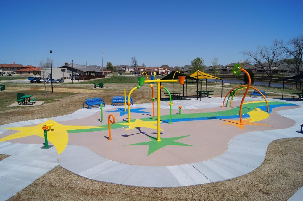 This stunning playground was created using Micro-Top XT by Bomanite, a toppings system that provides a cost-effective way to achieve multiple colors and complex designs, turning this concrete hardscape into a vibrant work of art.