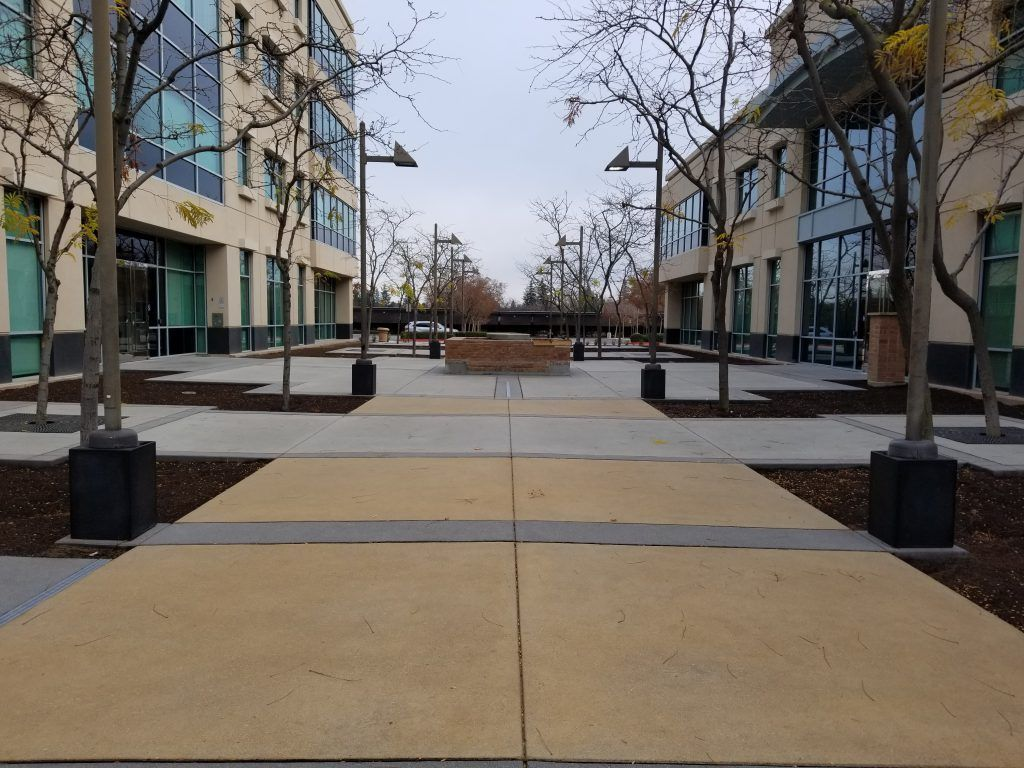 Bomanite Sandscape Texture was expertly designed and installed at the Village Courtyard, creating a beautiful balance of color, texture, and pattern that perfectly complements the exterior of the adjacent buildings.