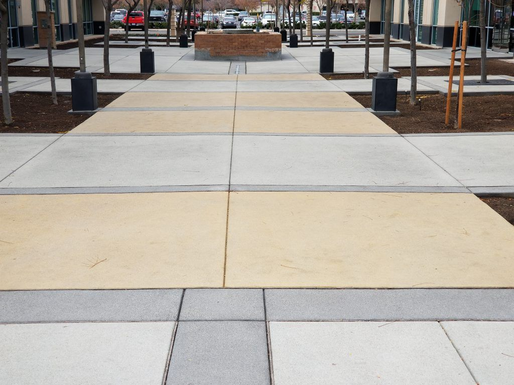 Bomanite Sandscape Texture was installed here to create a decorative concrete hardscape at the Village Courtyard, adding visual interest and dimension with the use of color and texture.