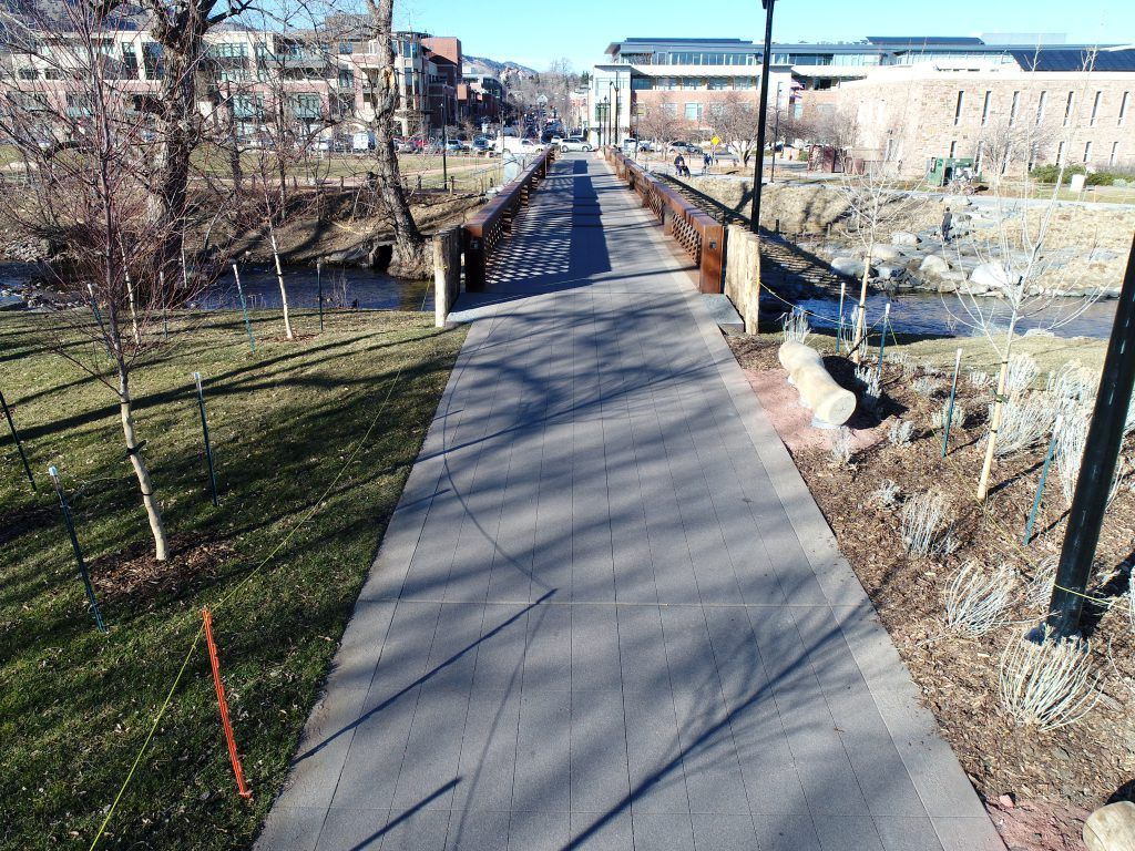 Bomanite Sandscape Texture decorative concrete was installed here at the Boulder Civic Area Park to create a durable and functional bridge that adds texture, dimension, and character to the hardscape.