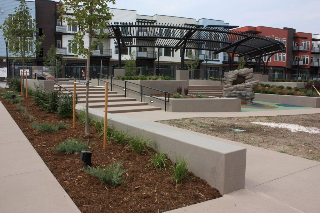 DELO - Downtown East Louisville, CO using Bomanite Exposed Aggregate Systems with Bomanite Sandscape Refined and a Gold Award Winner and a Grand Award Winner in 2017.