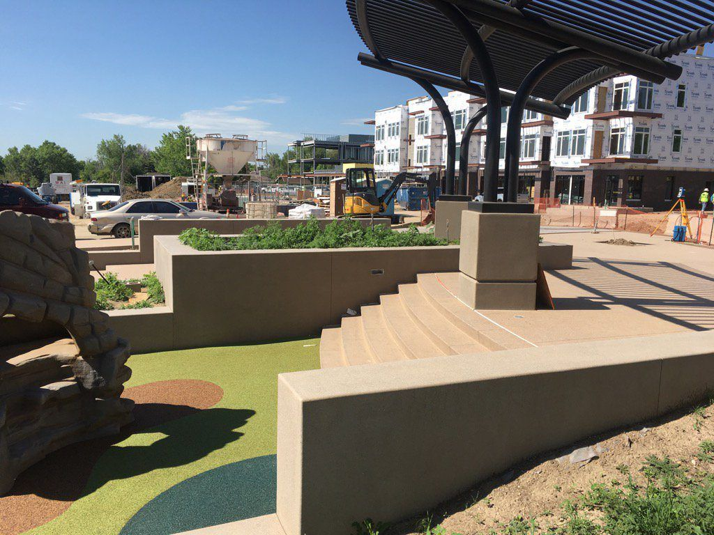 DELO - Downtown East Louisville, CO using Bomanite Exposed Aggregate Systems with Bomanite Sandscape Texture and a Gold Award Winner and a Grand Award Winner in 2017.