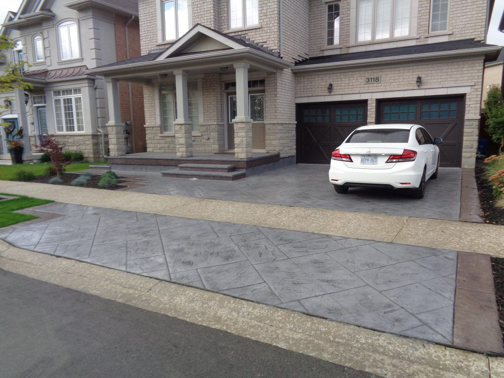 Featured here is the Bomanite Imprint System with Bomanite Bomacron patterns that were used to create this award-winning stamped concrete driveway and entryway, adding visual appeal to the exterior of this home with the use of pattern, texture, and color.