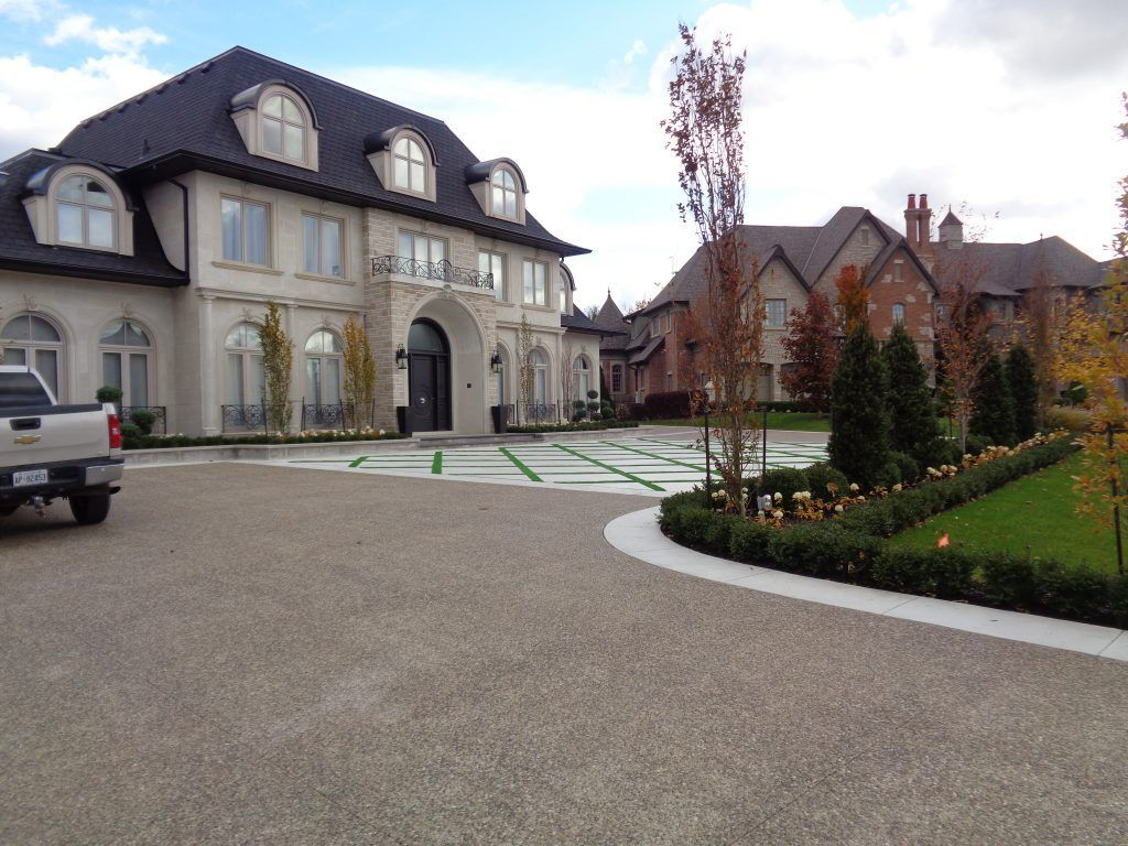 This impressive private residential driveway was created using Bomanite Exposed Aggregate Sandscape Texture for a durable and distinctive finish that complements the exterior of this beautiful home.