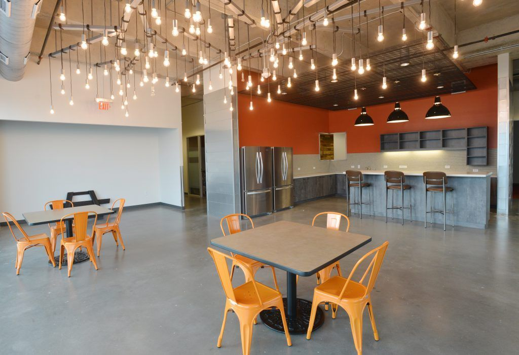 From the modern lighting to the Bomanite custom polished concrete floors, this space is a perfect balance of texture, color, and industrial style.