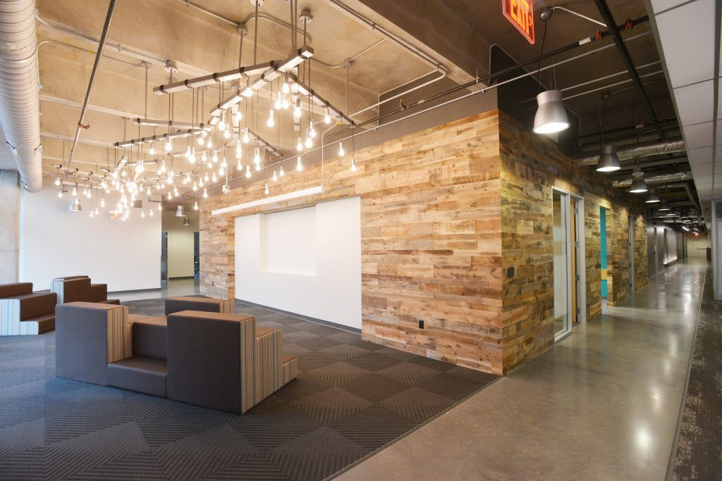 These Bomanite custom polished concrete floors are a grounding element of design for this modern, industrial office space, adding beauty and elegance to the space while tying everything together.