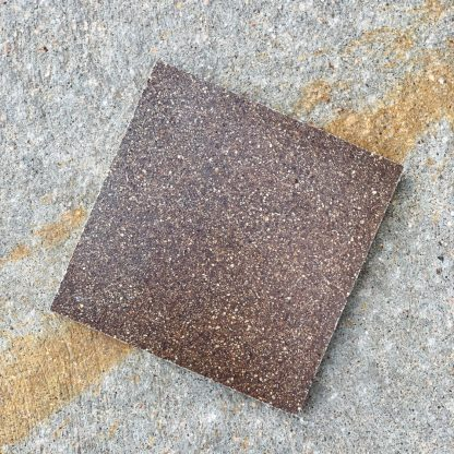 Bomanite Toppings Systems using Seal Brown Chemical Stain on uncolored ground concrete - product sample