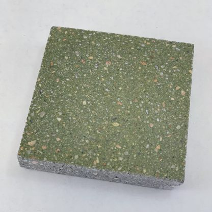 Bomanite Toppings Systems using Olive Chemical Stain on uncolored ground concrete in a 3x3 sample.