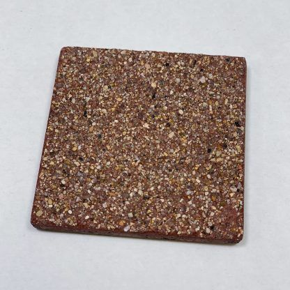 Bomanite Exposed Aggregate Systems using Brick Red Sandscape in a 3x3 sample.